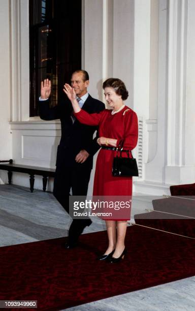 Queen Elizabeth II and Prince Philip Duke of Edinburgh wave to Queen Beatrix of Holland as she departs Buckingham Palace on November 19 1982