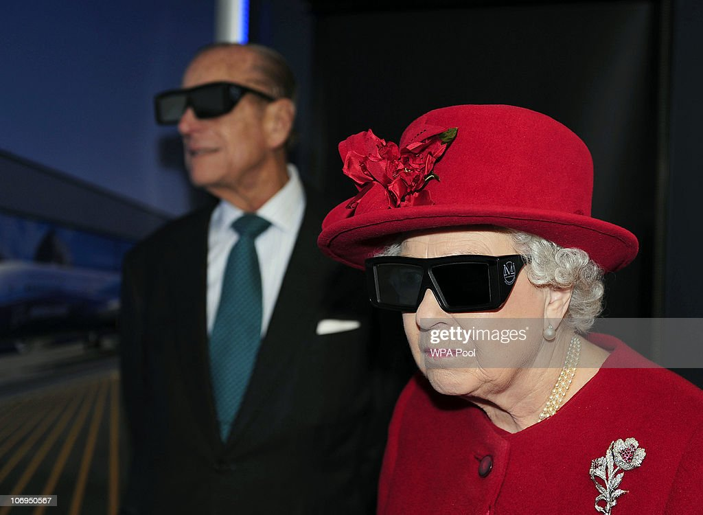 Queen Elizabeth II and Prince Philip, Duke of Edinburgh wear 3 D glasses to watch a display and pilot a JCB digger, during a visit to the University of Sheffield Advanced Manufacturing Research centre, on November 18, 2010 in Sheffield, England.
