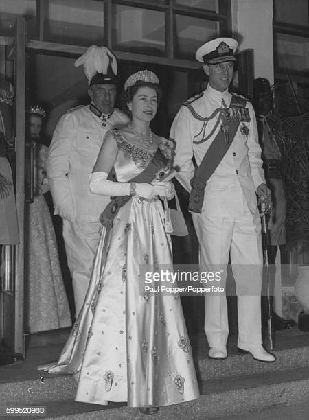 Queen Elizabeth II and Prince Philip Duke of Edinburgh wearing formal dress and the blue sash of the Order of the Garter attend a meeting of the...