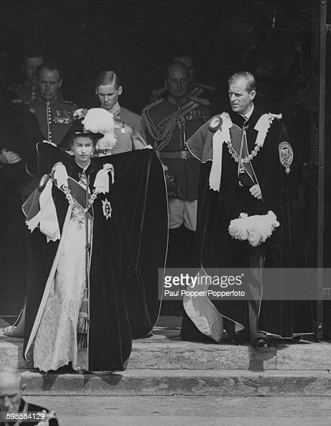 Queen Elizabeth II and Prince Philip Duke of Edinburgh wearing robes of the Order of the Garter as they leave St George's Chapel in Windsor after...