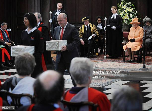 Queen Elizabeth II and Prince Philip, Duke of Edinburgh, who is the Chancellor of Cambridge University, attend a service at King's College, Cambridge...