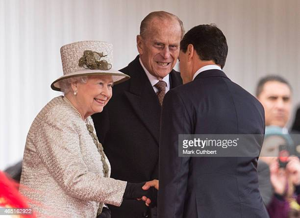 Queen Elizabeth II and Prince Philip, Duke of Edinburgh with Senor Enrique Pena Nieto at a ceremonial welcome for the State Visit of The President of...