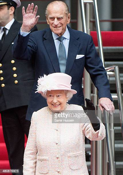 Queen Elizabeth II and Prince Philip Duke of Edinburgh's leave Lloyd's of London during a visit to the City of London on March 27 2014 in London...