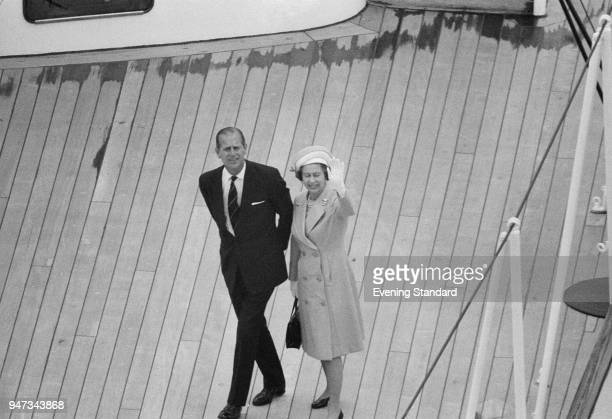 Queen Elizabeth II and Prince Philip during the Royal Progress trip via boat down the River Thames from Greenwich to Lambeth London UK 9th June 1977