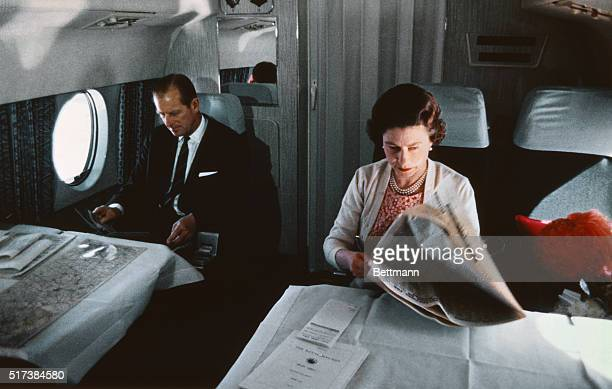 Queen Elizabeth II and Prince Philip fly back from a visit to Yorkshire in an Andover of the Queen's Flight in a photo taken during the filming of...