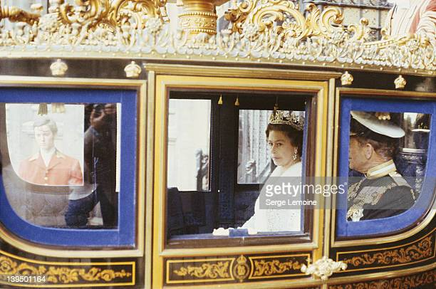 Queen Elizabeth II and Prince Philip in the royal coach during the State Opening of Parliament circa 1980