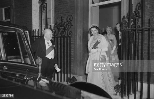 Queen Elizabeth II and Prince Philip leave 10 Downing Street in London after having dinner with Sir Winston Churchill , the British Prime Minister...
