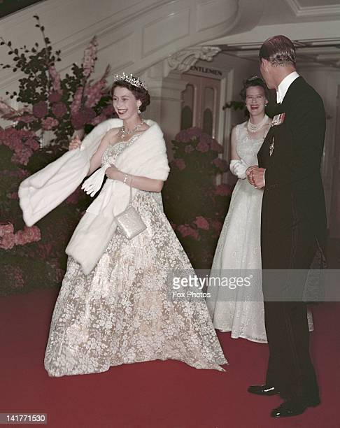 Queen Elizabeth II and Prince Philip leave a banquet during their Commonwealth visit to Australia 1954