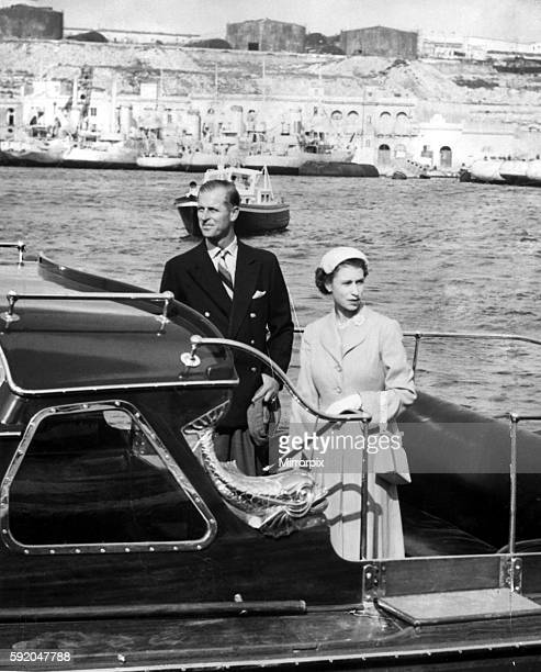 Queen Elizabeth II and Prince Philip leave Malta harbour to go aboard the Royal Yatch Britannia during the Royal Tour of the Commonwealth