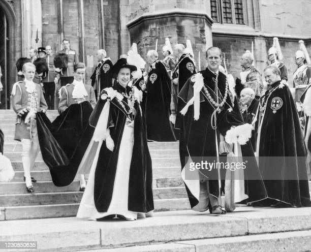 Queen Elizabeth II and Prince Philip leave Saint George's Chapel in Windsor following the ceremony in which three Knights of the Order of the Garter...
