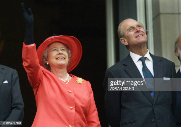 Queen Elizabeth II and Prince Philip look up from the balcony of Buckingham Palace as Concorde flies past during the Golden Jubilee celebrations in...