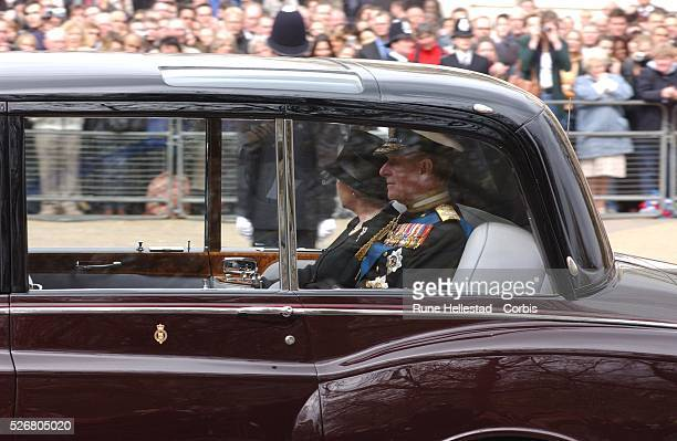 Queen Elizabeth II and Prince Philip make their way to Buckingham Palace following the funeral of the Queen Mother