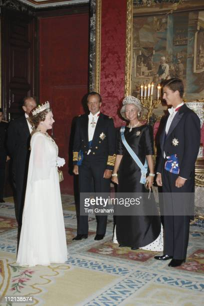 Queen Elizabeth II and Prince Philip meeting King Juan Carlos I of Spain Queen Sofia of Spain and their son Felipe Prince of Asturias at the Palacio...