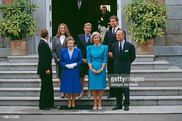 Queen Elizabeth II and Prince Philip on a state visit to Spain seen here with the Spanish Royal Family. L - R; Juan Carlos I, Princess Elena of...
