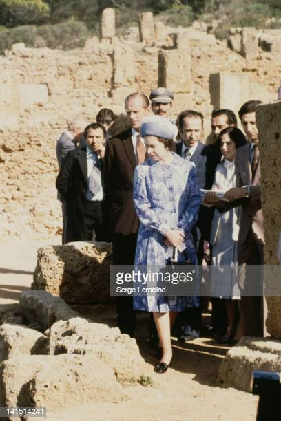 Queen Elizabeth II and Prince Philip on a tour of an ancient site during a state visit to Algeria October 1980