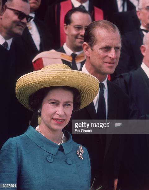 Queen Elizabeth II and Prince Philip on an official visit to Malta, 17th November 1967. The Queen wears a turquoise jacket with brooches, and a large...