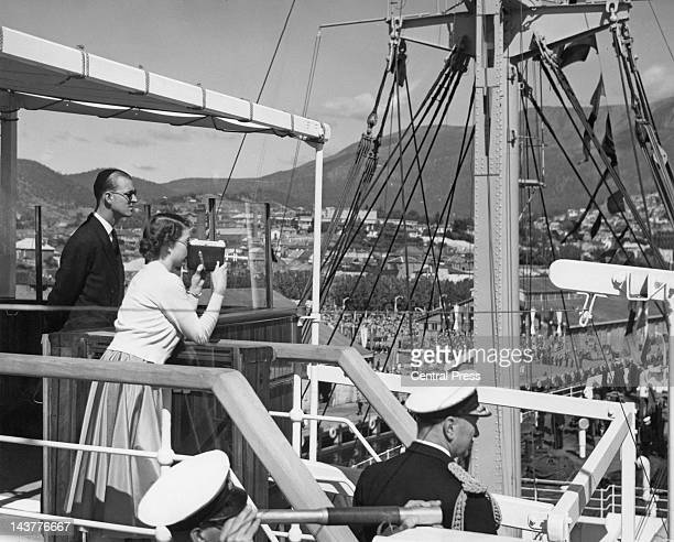 Queen Elizabeth II and Prince Philip on the bridge of the royal yacht 'SS Gothic' as it enters Hobart harbour in Tasmania 20th February 1954