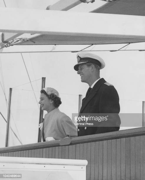 Queen Elizabeth II and Prince Philip on the bridge of the SS Gothic as they leave Bluff Harbour, New Zealand, on their way to Australia, during the...