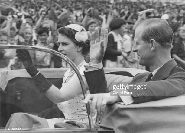 Queen Elizabeth II and Prince Philip returning to Government House after attending a youth rally in Auckland Domain in Auckland New Zealand during...