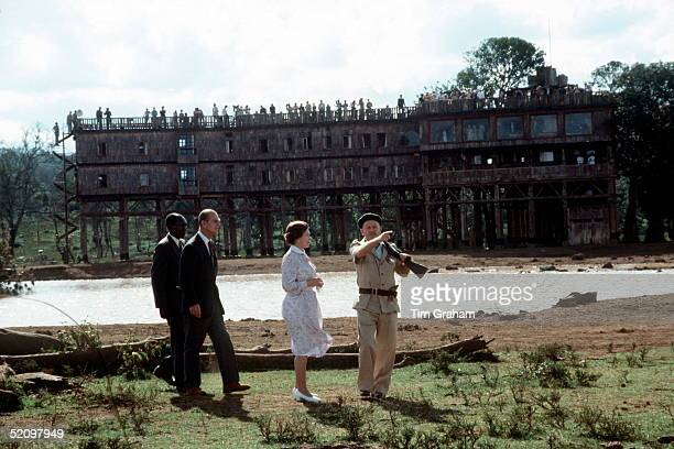 Queen Elizabeth II And Prince Philip Revisiting Treetops With An Armed Guide To Protect Them In The African Bush Where During A Visit Here In 1952...