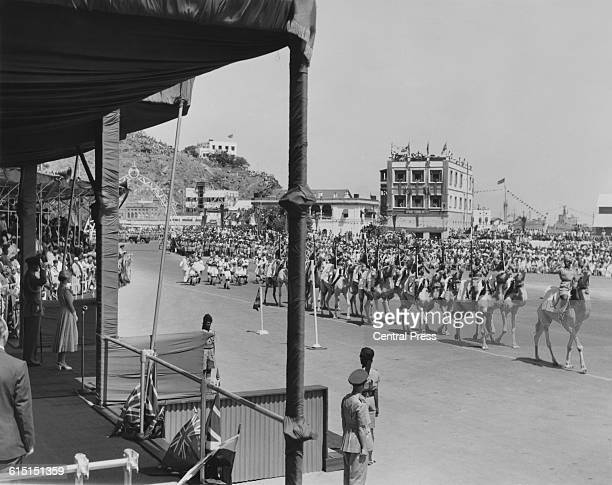 Queen Elizabeth II and Prince Philip take the salute as troops of the Aden Protectorate Levies march past in the Crescent Gardens Aden Yemen April...