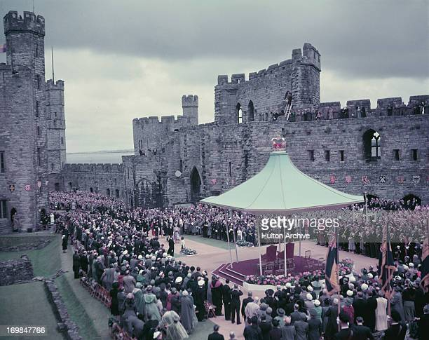 Queen Elizabeth II and Prince Philip the Duke Of Edinburgh approach the dais at Caernarvon Castle during her Coronation tour of Wales 11th July 1953