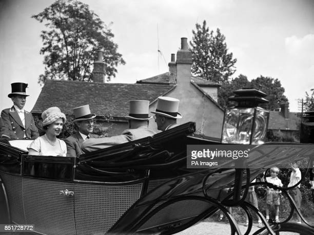 Queen Elizabeth II and Prince Philip the Duke of Edinburgh are pictured in the landau as they arrive at the Golden Gates to drive down the course on...