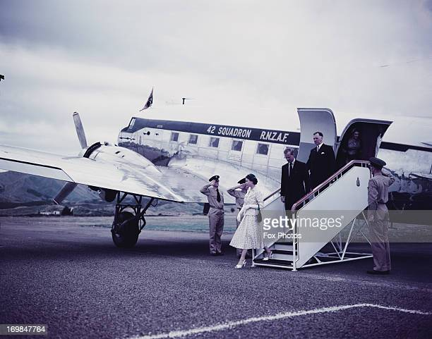 Queen Elizabeth II and Prince Philip the Duke of Edinburgh are pictured leaving the aeroplane at Westport Airport during her Commonwealth visit to...