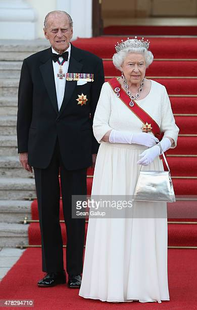 Queen Elizabeth II and Prince Philip, the Duke of Edinburgh, arrive for the state banquet in their honour at Schloss Bellevue palace on the second of...