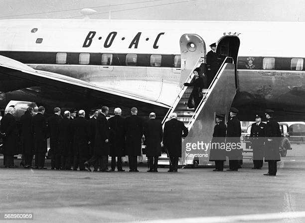 Queen Elizabeth II and Prince Philip the Duke of Edinburgh leaving their BOAC airplane as they return from Kenya following the death of King George...