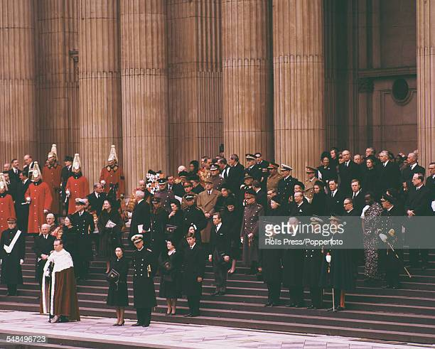 Queen Elizabeth II and Prince Philip The Duke of Edinburgh stand with members of the British royal family and International dignitaries on the steps...