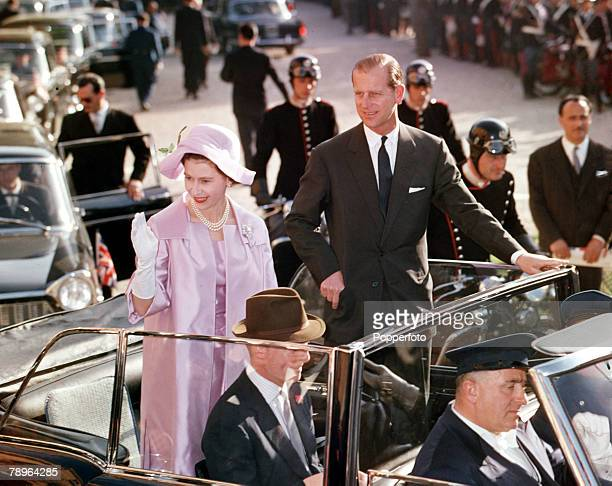 Queen Elizabeth II and Prince Philip, the Duke of Edinburgh, touring the streets of Rome in an open-topped car during their 1961, Royal Tour to Italy.