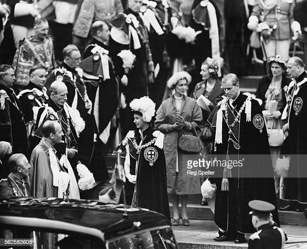 HM Queen Elizabeth II and Prince Philip the Duke of Edinburgh wearing their Garter robes as they walk towards their car after a ceremony where the...