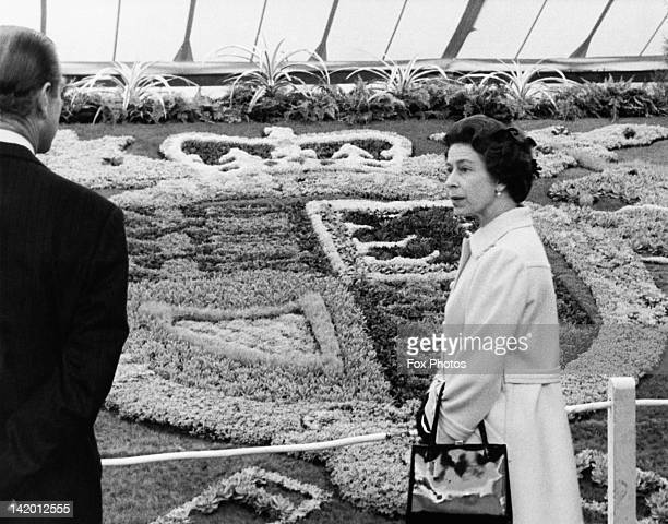 Queen Elizabeth II and Prince Philip viewing the carpet bedding of the Royal Coat of Arms during a tour of the Chelsea Flower Show London 19th May...