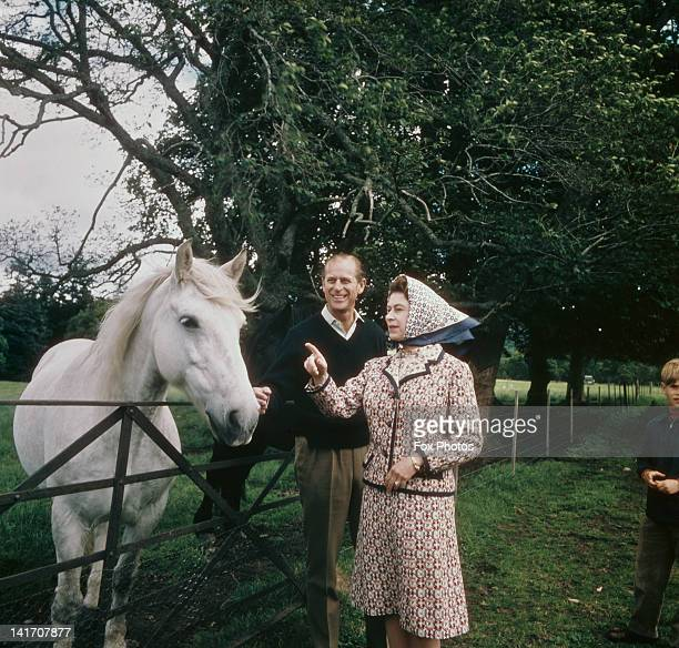 Queen Elizabeth II and Prince Philip visit a farm on the Balmoral estate in Scotland, during their Silver Wedding anniversary year, September 1972.