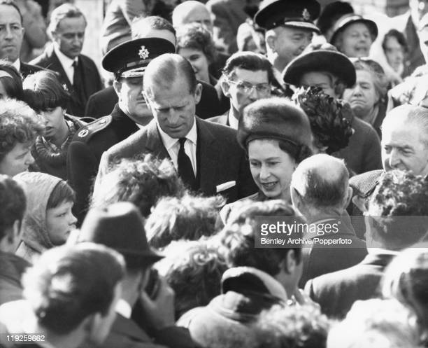 Queen Elizabeth II and Prince Philip visit the coalmining village of Aberfan in South Wales eight days after the disaster in which 116 children and...