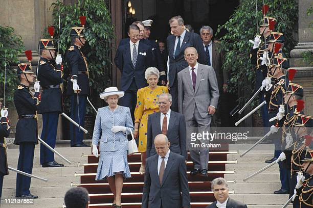 Queen Elizabeth II and Prince Philip walking through a guard of honour in Paris while on an official state visit to France 10 June 1992