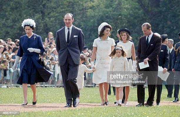 Queen Elizabeth II and Prince Philip walking with Jaqueline Kennedy, her daughter Caroline and John F Kennedy Junior , on the occasion of the...