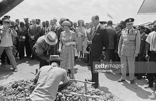 Queen Elizabeth II and Prince Philip watch diamondsorters at work in Georgetown British Guyana during a royal tour of the Caribbean February 1966