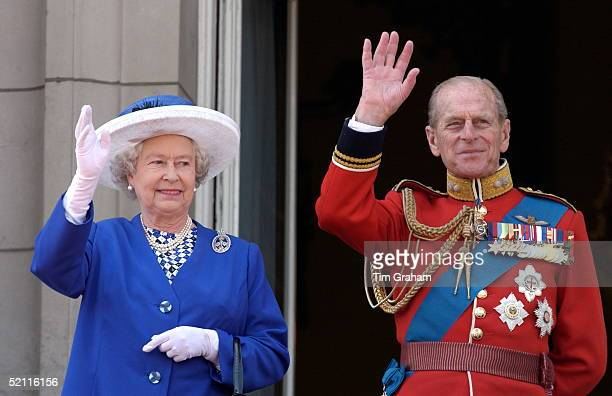 Queen Elizabeth II And Prince Philip Waving From The Balcony Of Buckingham Palace After Trooping The Colour Wearing His Guards Uniform With Medals...