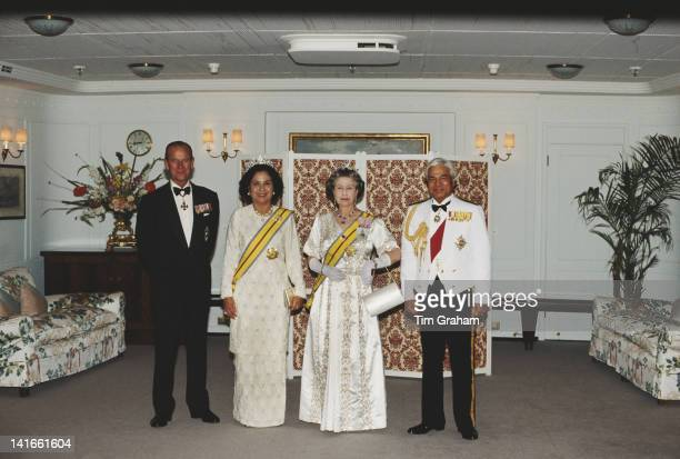 Queen Elizabeth II and Prince Philip with Azlan Shah of Perak the Yang diPertuan Agong of Malaysia and his wife Tuanku Bainun on board the Royal...