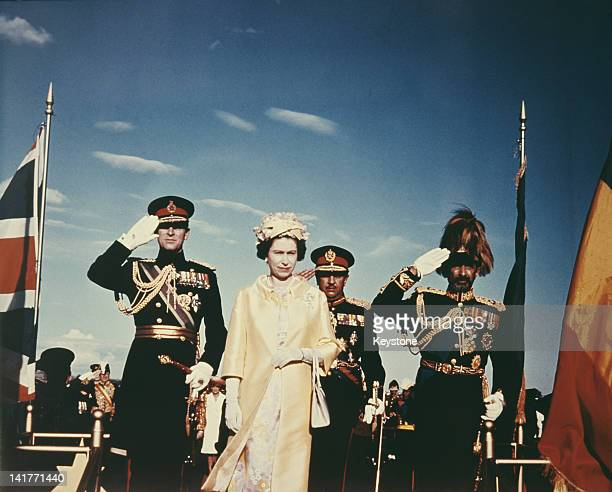 Queen Elizabeth II and Prince Philip with Emperor Haile Selassie I of Ethiopia upon their arrival in Addis Ababa during a State Visit to Ethiopia...