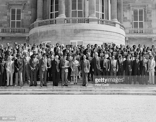 Queen Elizabeth II and Prince Philip with members of the teams competing in the inaugural Cricket World Cup competition outside Buckingham Palace...