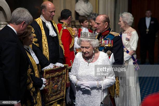 Queen Elizabeth II and Prince Phillip Duke of Edinburgh are escorted through the Norman Porch of the Palace of Westminster after attending the State...