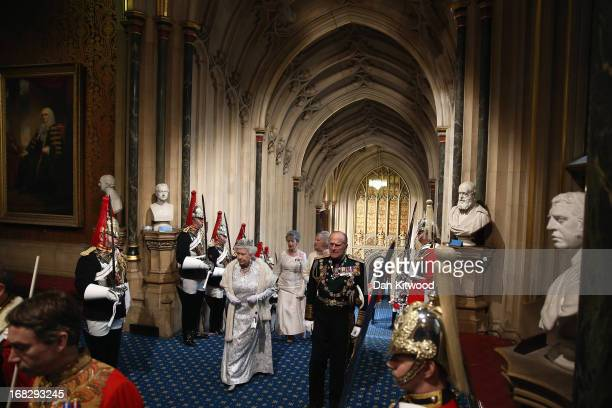 Queen Elizabeth II and Prince Phillip Duke of Edinburgh arrive ahead of the State Opening of Parliament on May 8 2013 in London England Queen...