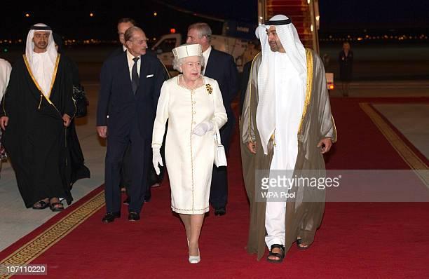 Queen Elizabeth II and Prince Phillip Duke of Edinburgh arrive at Abu Dhabi Airport on November 24 2010 in Abu Dhabi United Arab Emirates Queen...