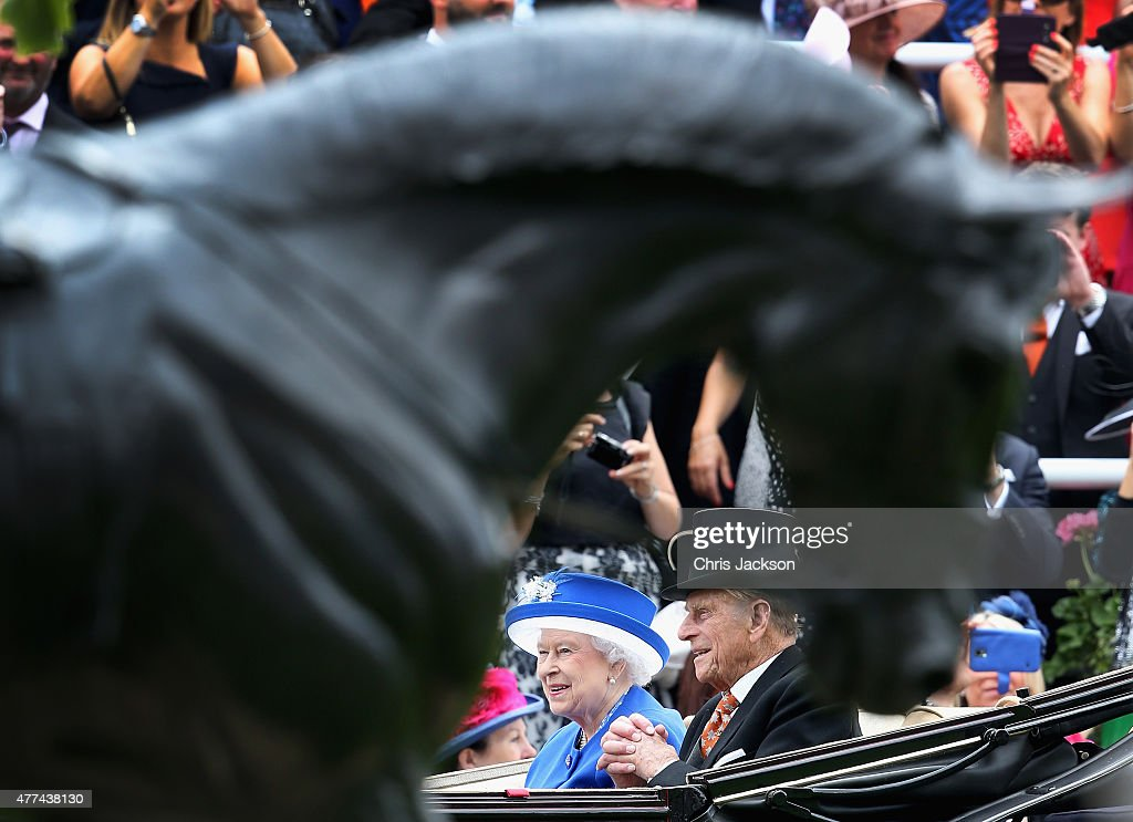 Queen Elizabeth II and Prince Phillip, Duke of Edinburgh arrive in the royal carriage for day 2 of Royal Ascot at Ascot Racecourse on June 17, 2015 in Ascot, England.