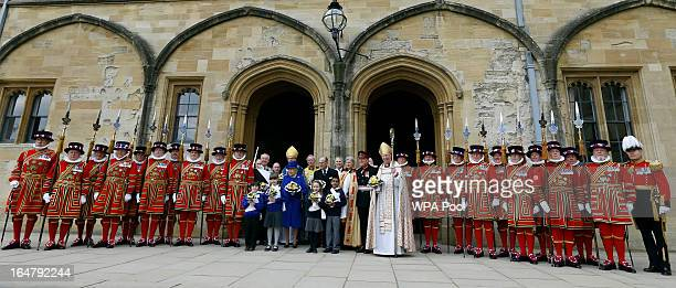 Queen Elizabeth II and Prince Phillip Duke of Edinburgh pose with children and Yeoman of the Guard after attending the Maundy service at Christ...