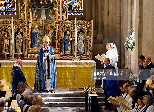 Queen Elizabeth II and Prince Phillip Duke of Edinburgh stand during the Maundy service conducted by the Bishop of Worcester Dr John Inge at Christ...