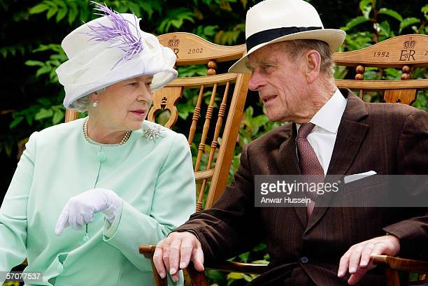 Queen Elizabeth II and Prince Phillip the Duke of Edinburgh chat while seated during a musical performance in the Abbey Gardens Bury St Edmunds...